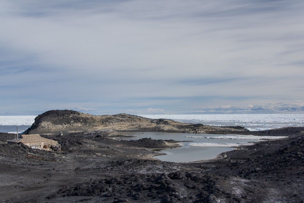 Cape Royds penguin colony with Shackleton's hut.