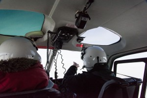 Helmets are equipped with microphones so passengers can communicate with the pilots during the trip. McMurdo pilots like pointing out the sights. On this trip, returning from New Harbor, I was sitting in the back seat of a four-seat helicopter.