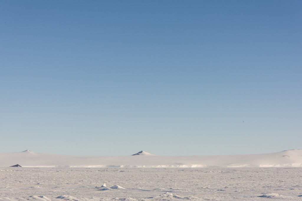 Distant mountain across the sea ice